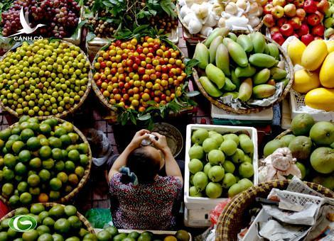 Justin Mott/Bloomberg. A vendor sells produce at the Cho Hom market in Hanoi, Vietnam.