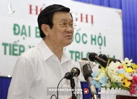 President Truong Tan Sang talks with voters
