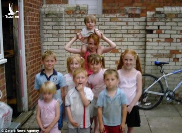 Athena pictured (centre right, with yellow hair ties) in a childhood photo with her brothers and sisters