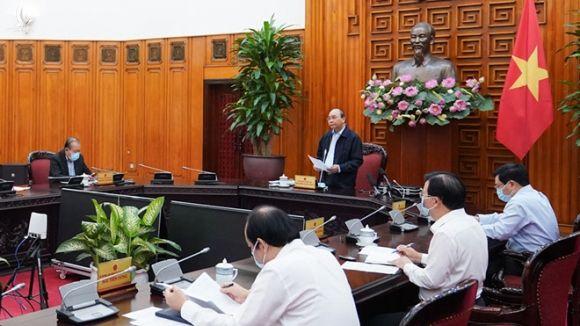 Thủ tướng Nguyễn Xuân Phúc chủ trì cuộc họp sáng 26.3 /// Ảnh Quang Hiếu