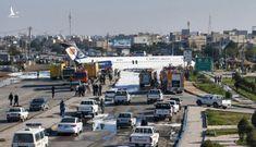 Máy bay Iran chở 144 người trượt khỏi đường băng, lao ra xa lộ