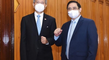 Thủ tướng Phạm Minh chính đề nghị Singapore chia sẻ công nghệ, hợp tác vắc xin
